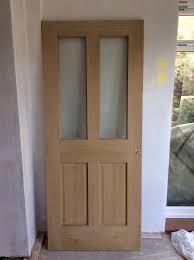 oak veneer internal door with glass panels wickes cobham