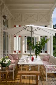 classic front porch idea painted in white ikea table and bench sets with matching pillow throws