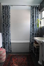 Decor Tip Hang Double shower curtains at the ceiling for a more