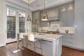 example of a classic galley dark wood floor kitchen design in dc metro with an undermount