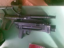 f88 austeyr. steyr aug a1 with a 40 mm ag36 grenade launcher. f88 austeyr