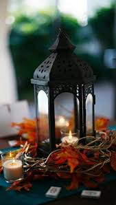 Lantern wedding centerpiece Amazing Black Candle Lantern With Fall Leaves And Candles Around Happyweddcom 35 Chic Lantern Wedding Centerpieces Happyweddcom