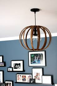 inspired by a west elm piece tasha from designer trapped in a lawyer s figured out how to create this cool bent wood pendant lamp using embroidery