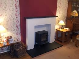 stove in black white modern looking fireplace surround