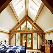 rooflights in a vaulted ceiling of a bedroom with timber frame