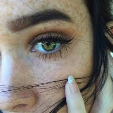 is this a pretty with freckles yes does she have green eyes yes brown hair yes thank you finally