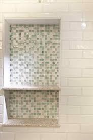 white subway tile shower niche