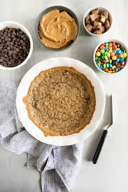 this effortless chocolate chip cookie cake recipe starts with bought cookie dough topped with