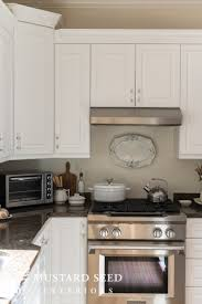 decorating above kitchen cabinets. Higher Or Because The Wall Color Is More Neutral Stirrup Pants And Bodysuits Are Coming Back In Style, So Why Not A 1990\u0027s Decorating Trend? Above Kitchen Cabinets