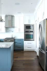 white kitchen cabinets with blue glass backsplash white upper cabinets with blue lower cabinets with pale