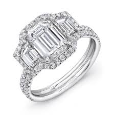 uneek emerald cut diamond three stone engagement ring with round diamond halo and pave double shank