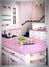 Kitchen with pink counter tops & pink brick wall