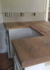 diy reclaimed wood countertop adding trim boards along edge