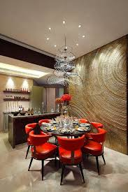 love the tree ring walls the red dining room chair and the great chandelier