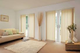 gorgeous vertical blinds sliding patio door window treatments with modern sleeper couch as well as square living rugs in white beautiful living room designs