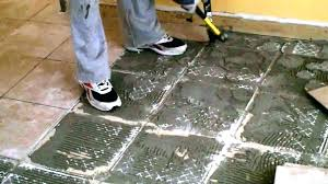 how to remove ceramic tile from concrete floor stunning old removing flexible adhesive