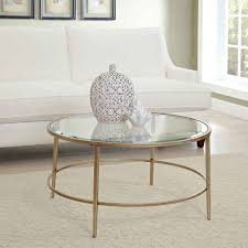 round small glass coffee table with iron legs for a small modern living room design