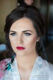 brunette bridesmaid makeup blue eyes dramatic false lashes canberra wedding makeup