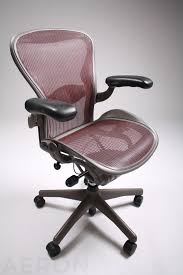 elegant and stylish marroon herman miller aeron chair parts design with black armrests and black metal