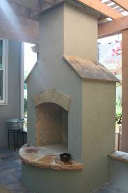 stucco fireplace with flagstone accents
