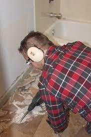 bathroom floor remodel. Tearing Out The Floor Tile In A Modern Bathroom Remodel