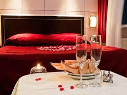 Romantic bedroom decorating ideas, rose petals, candles, red bedding set
