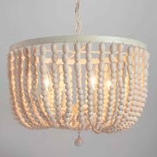 wood beaded chandelier wonderful corinne parts white beam diy for wooden bead chandelier uk