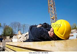 construction worker taking a nap on construction site stock image business nap office relieve