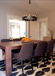 barn chandelier casts rustic light onto dining room table