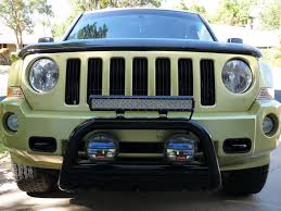 2016 jeep patriot with 3 inch pull bar hood decal painted black fender flares and wheels roof fog lights and roof rack