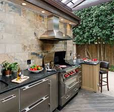 climbing plants outdoor kitchen design light brown stone veneer simple natural stone island stone soncrete island