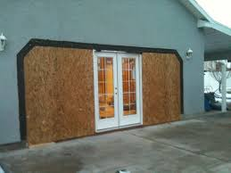 double garage doors for large garages where a person tends to work on their car there is more room in a large garage for this purpose