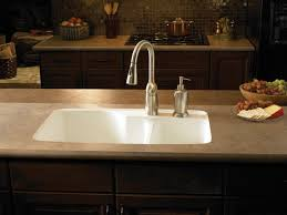 integrated sink is mounted flush with a laminate countertop with no lip this style can be achieved with granite stainless steel sinks