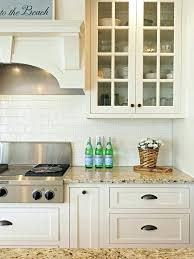 white countertops with white subway tile backsplash gold light granite with off white subway tile and