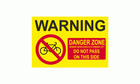 Warning Danger Zone Beware When Vehicle Is Turning Left Do Not Pass On This Side