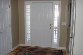 white front door inside. White Wooden Front Door With Full Length Sidelight Added By Internal Blinds And Golden Knobs At Beige Wall Theme Inside O