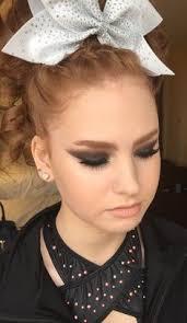 teased cheer hair curls ponyl braid cheer hair and makeup white cheer bow all star cheer