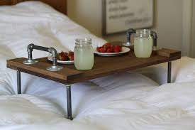 rustic industrial diy breakfast over the bed tray table made from galvanized pipe legs and handle combined with reclaimed wood tray table ideas