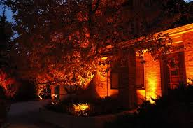 outdoor lighting effects. lighting effects with orange lens covers outdoor e