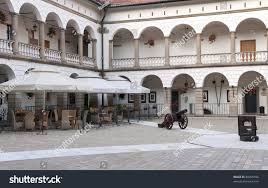 Courtyard in niepolomice castle near krakow poland with an outdoor restaurant and cannon