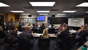 partints in the garden grove pd s recent predator sting team are briefed at police headquarters before heading out to the motel