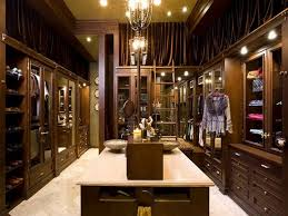 luxury dark wood modern walk in dressing room with chair custom closet design