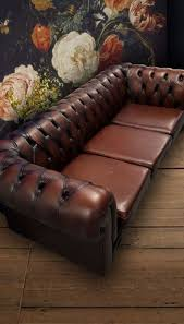 dark brown leather chesterfield sofa and chair