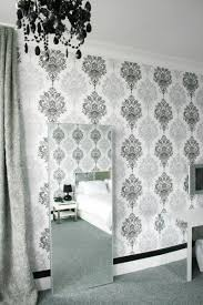 white silver and black wallpaper black chandelier black and