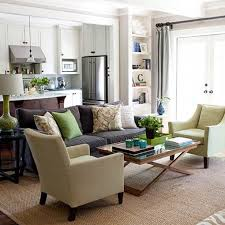 brown sofa green accents bhg bhg living rooms yellow