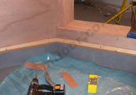 applying a waterproof substrate to a shower tray with wooden batton