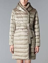 Exaggerated Proportions: Max Mara 'Manuela' camel coat, mini skirt ... & Max Mara NOVEUU light: Reversible padded coat. Adamdwight.com