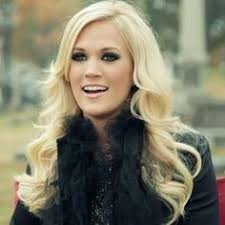 carrie underwood love how she can pull off the super pale hair and smokey eye