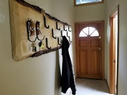 Carabiner Coat Rack Mammoth Life Page 100 A normal person living at the base of 44