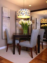 casual dining room lighting with low ceiling polkadot drum shade pendant lamp over white tulips centerpiece in glass vase on square dining tables plus grey